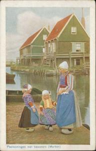 Dutch Family mother children typical costume Paalwoningen Marken