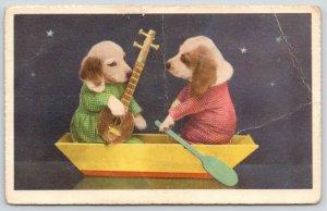 Artist~Dressed Puppies in Boat~He w/Paddle~She Serenades w/Mandola~Switzerland