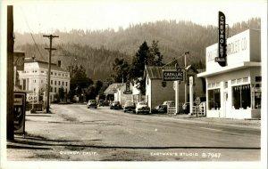 Vtg Postcard RPPC Quincy CA Eastman's Studio B-7947 Street View Chevy 76 Signs