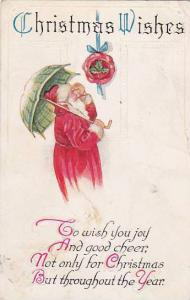 Santa Claus holding umbrella looking up at door ornament, Christmas Wishes, PU
