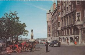 Popular horsedrawn sightseeing carriages, The Chateau Frontenac & Place d'Arm...