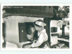 old rppc GERMAN KIDS KISSING Country Of Germany i2042