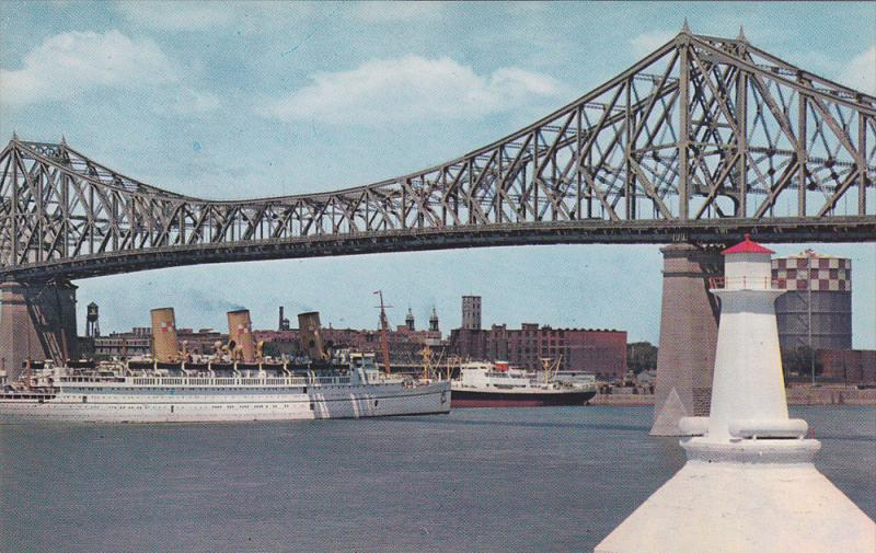C.P. Ocean Liner EMPRESS of SCOTLAND passing under Jacques Cartier Bridge ,...