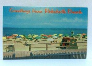 Rehoboth Beach Delaware Relaxing At Beach Umbrellas Postcard