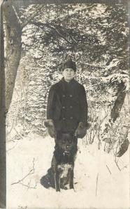 c1910s RPPC Postcard Man in Snow with Black Siberian Husky Type Dog unknown US