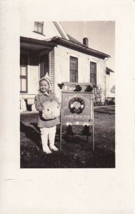 RP: Little Girl w/hand muff, Merry Christmas/Happy New Year Sign, 1910-20s