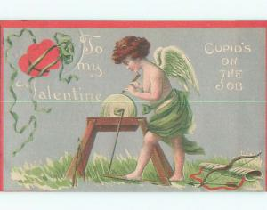 Pre-Linen valentine CUPID SHARPENS ARROWS ON GRINDSTONE WHEEL J0643
