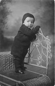 Young child standing on chair Child, People Photo 1916