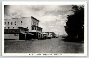 Saratoga Wyoming~Main Street~Donelan Pharmacy~Hotel~1930s Cars~B&W Postcard