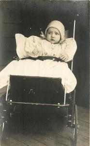 Real Photo Postcard~Unsure Marion McNitt~Baby Strapped~Vintage Stroller~1912