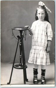 1910s RPPC Photo Postcard Little Girl with Funny Look on Face, Studio Portrait