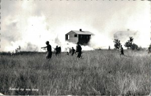 Military Dutch postcard Aanval op een dorp RPPC 3.30