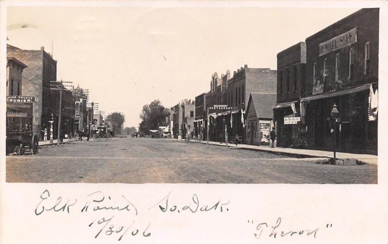 Elk Point SD~Main Street~Union County Courier Newspaper~Harness~Barber~1906 RPPC