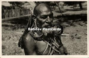 dutch new guinea, Papua with Hair Extensions Earrings of Casuar Pens 1950s RPPC