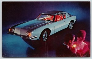 Studebaker~Lit-Up Inside the Avanti 4 Speed~Supercharged~Man Lights Up Cigarette