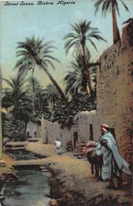 11804  Algeria  Biskra 1910  Street next to stream and buildings