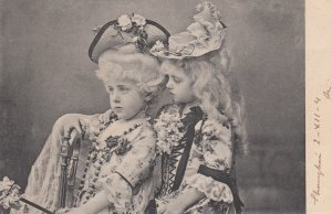 2 Victorian dressed girls in a basket , 1904 ; TUCK 1155