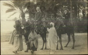 Palermo or Biskra Tourists on Camels Muslims Guides 1914 Real Photo Postcard