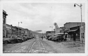 St. Maries ID Dirt Street Bungalo Theatre Movie Marque Stores Cars RPPC Postcard