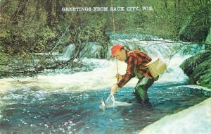 Sauk City Wisconsin~Man Fishing River~Waders~Landing Net~Basket~1960s Postcard