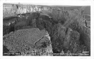 H28/ Sinking Farm Idaho RPPC Postcard c30s Cracking Hay Field Chasm Geology