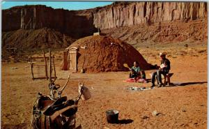 NORTHERN ARIZONA  NAVAJO FAMILY at HOGAN  Saddle    c1950s   Postcard
