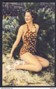 Swimsuit - pin-up woman brown one piece bathing suit, posing on sand