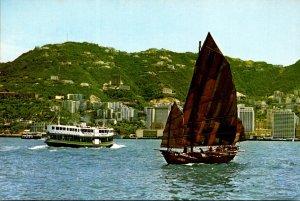 Hong Kong Harbor A Modern Ferry and An Ancient Junk