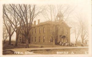 Redfield Iowa~Public School~Children & Teacher Outside~Houses~Barn~c1915 RPPC