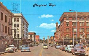 Cheyenne WY Business Section Storefronts Old Cars Movie Theatre Postcard