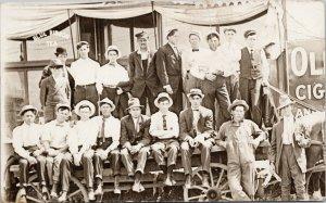 Men Sitting on Wagon Travelling Circus ?? Blue Ribbon Tea Postcard E74 *as is