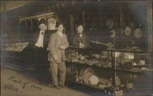 St. Paul MN Music Store Interior Banjos Men at Counter c1910 Real Photo RPPC