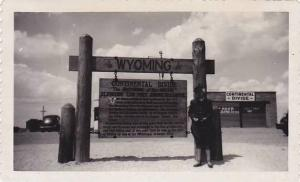 RP: Woman standing in front of sign, Continental Divide, The Backbone of the ...