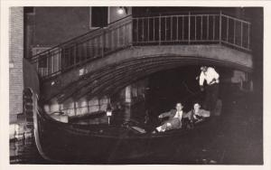 RP; Tourist riding in a gandola, Rialto Bridge, Venice, Italy, 10-20s