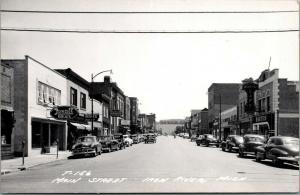 Iron River Michigan~Main Street~Mertin's Cafe~Irene's Dress Shop~Cars~1950s RPPC