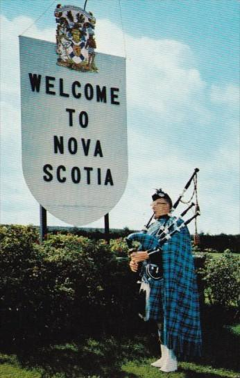 Canada Piper At Welcome Sign Nova Scotia