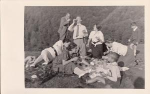 RPPC 1937 FAMILY TRIPPERS EXCURSIONISTS HAVING GRASS PICNIC PICNICKERS CAMPING