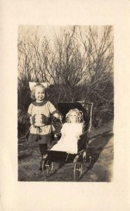 RPPC Girl & Doll in Baby Carriage Antique Toy c1910s Vintage Postcard