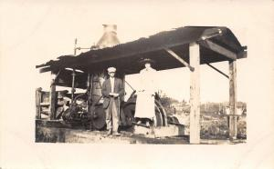 Real Photo Postcard~Roof Covers Steam Contraption~Young Couple by Pulleys~c1912