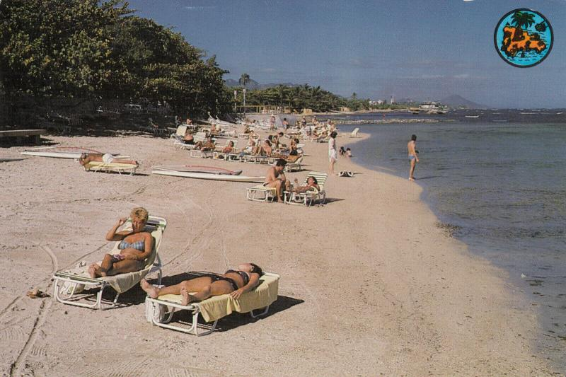 PUERTO PLATA, Dominican Republic, 40-60s; Playa Long Beach, people sunbathing