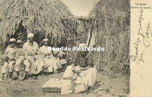 curacao, W.I., Familia de Negros, Black Family in front of Huts (1905)