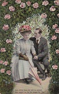 Romantic Couple Sitting Under Rose Arbor 1908
