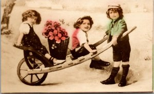 Postcard Wheelbarrow Children KIDS FLOWERS PHOTO 1910 UNPOSTED