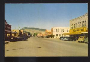 CODY WYOMING 1950's CARS DOWNTOWN STREET SCENE STORES VINTAGE POSTCARD