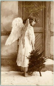 1910s German CHRISTMAS RPPC Postcard ANGEL w/ Xmas Tree Gesegnete Weihnachten