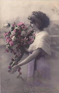 RP; Hand-colored, Vive Ste. Marie, Woman carrying large bouquet of flowers, P...