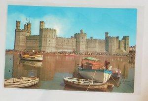 Vintage Postcard: Caernarvon- The Castle. Several boats, castle.