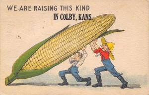 We Raise this Kind in Colby Kansas~2 Farmers Lift Exaggerated Ear of Corn~1915