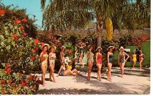 US    PC2567  FLOWERS & GIRLS AT WEEKI WACHEE, NORTH OF ST PETERSBURG, FL