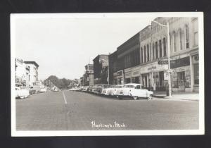 RPPC HASTINGS MICHIGAN 1950's CARS DOWNTOWN STREET SCENE REAL PHOTO POSTCARD